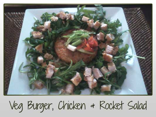 Veggie Burger, Chicken Tender, Baby Rocket Leaves, 1 Cherry Tomato, 1 Spring Onion, Pumpkin Seeds, Sunflower Seeds, Cayenne Pepper, Olive Oil, Coconut Oil, Walnuts, Flaked Almonds